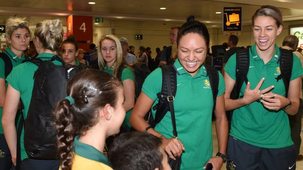 Welcome home: Kyah Simon and Alanna Kennedy (right) arrive at Sydney Airport.