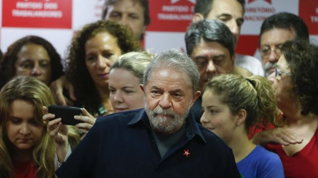 Brazil's former president Luiz Inacio Lula da Silva, centre, after being questioned in a snowballing corruption probe ...