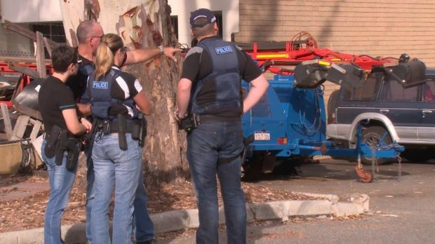 Police during one of the raids throughout the metropolitan area that smashed a drug ring.