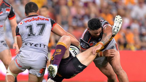 Stopped in his tracks: Josh McGuire is upended by Issac Luke.