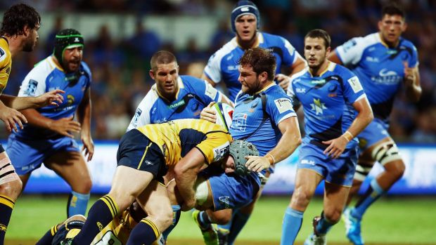 PERTH, AUSTRALIA - MARCH 11: David Pocock of the Brumbies tackles Ben McCalman of the Western Force during the round ...