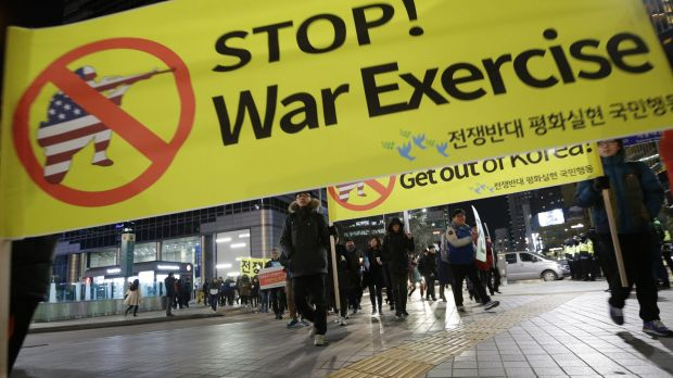 Protesters march toward the US embassy in Seoul during a rally opposing joint South Korea-US military exercises.