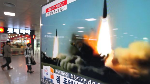 A TV screen shows a file footage of the missile launch conducted by North Korea, at Seoul Railway Station in Seoul, ...