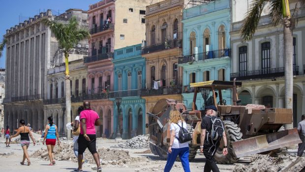 People walk amid renovation work in Havana, Cuba, ahead of a visit by Barack Obama.