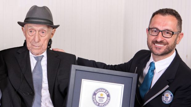 Marco Frigatti, from Guinness World Records, right, presents Israel Kristal a certificate for being the oldest living ...