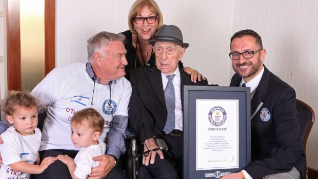 Israel Kristal with, from left to right, grandchildren Nevo and Omer, son Heim Kristal, and daughter Shula Kuperstoch, ...