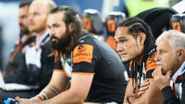 Opposite sides: Aaron Woods, left, will do battle with Martin Taupau, right, for the first time when the Tigers face ...