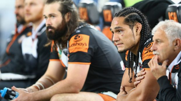 No sentiment: Aaron Woods and Martin Taupau will go head to head on Moday night.