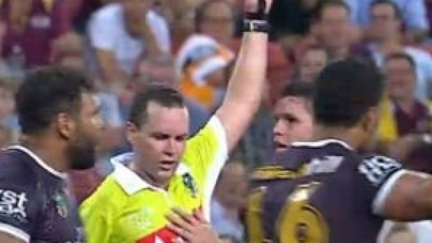 In trouble?: Brisbane's James Roberts touches referee Matt Noyen on Friday night.