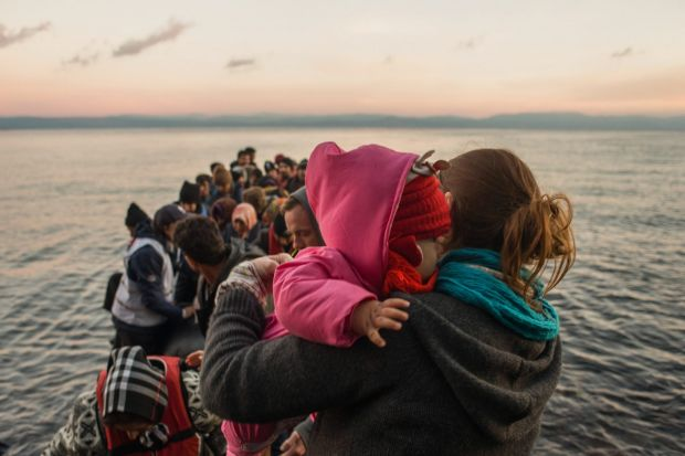 Lesvos, Greece, November 2015: A dinghy arrives with more than 60 Syrian refugees, most of them children.