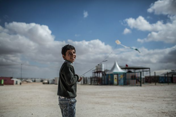 Zaatari refugee camp, Jordan, February 2015: Omar, 13, from Daraa in Syria, flies a kite. Every time I fly my kite, I ...