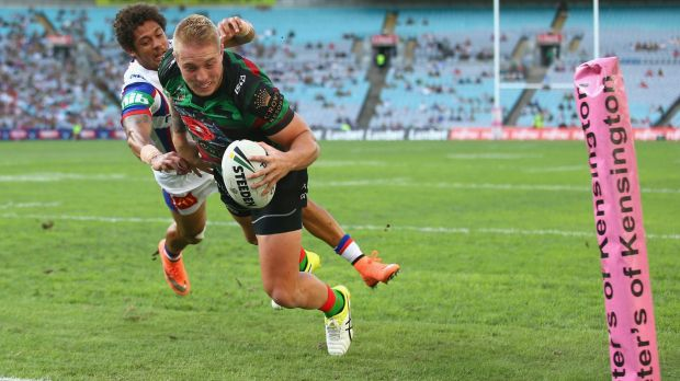 Flying to the line: Aaron Gray fends away from Dane Gagai to score.
