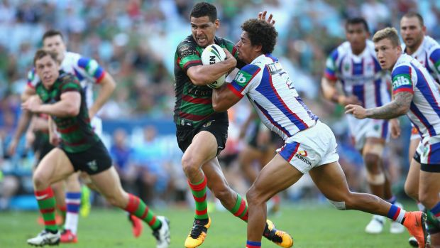 SYDNEY, AUSTRALIA - MARCH 12:  Cody Walker of the Rabbitohs is tackled by Dane Gagai of the Knights during the round two ...