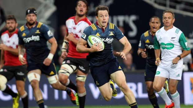 In a gap: Ben Smith attempts to bust the defence during the round three Super Rugby match between the Highlanders and ...