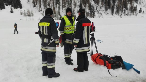 Rescuers prepare to board helicopters in Valle Aurina in the Italian Alps to reach the area on Monte Nevoso where six ...