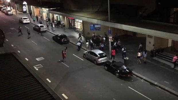 A resident filmed as the brawl broke out on the street below his apartment.