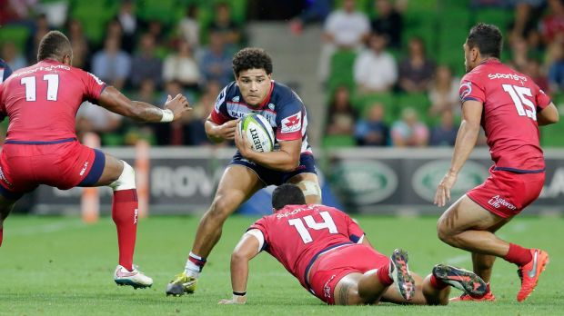 Sione Tuipulotu drives the ball forward on debut against the Reds