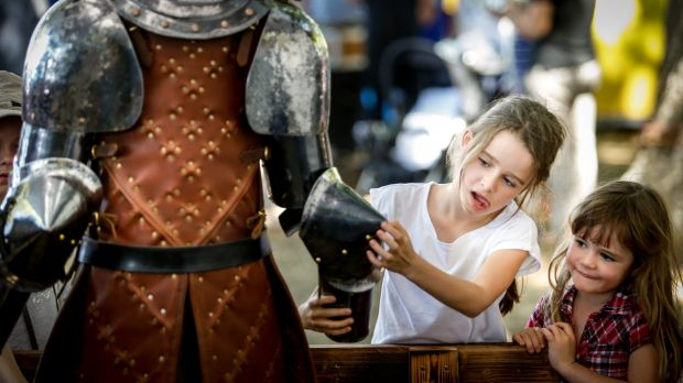Emme, 8, and sister Georgie, 5, investigate a Sam Bloomfield sculpture The Lost Trades Fair at Kyneton Racecourse
