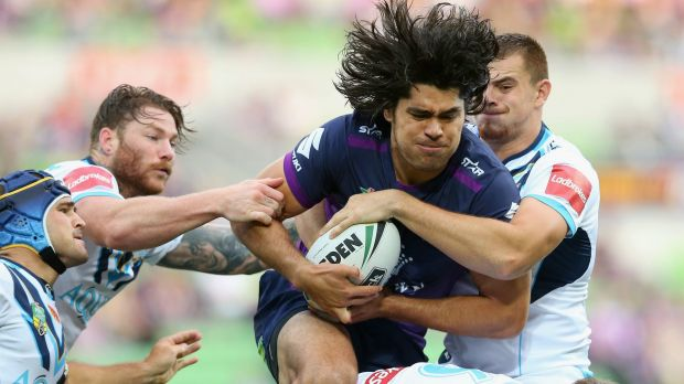 Evasive action: Tohu Harris of the Storm under pressure from all angles during the recent clash with the Titans at AAMI Park.