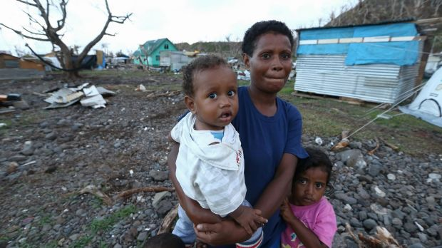 Locals on Koro Island, Fiji, after it was hit by Tropical Cyclone Winston.