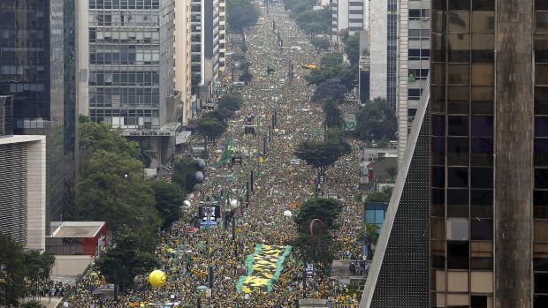 Demonstrators fill Sao Paulo's Avenida Paulista on Sunday during a protest demanding Rousseff's impeachment and an end ...