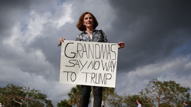 Mary Dickens holds a sign outside a Republican presidential candidate Donald Trump campaign rally in Florida on Sunday.