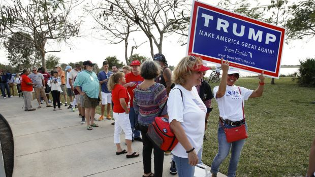 Trump supporters line up for a rally in Florida on Sunday.