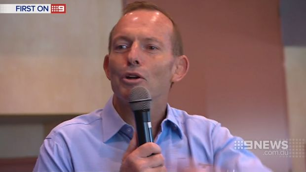 Tony Abbott struggles to conceal a grin as his supporters boo Malcolm Turnbull's name at a rally at Balgowlah RSL.