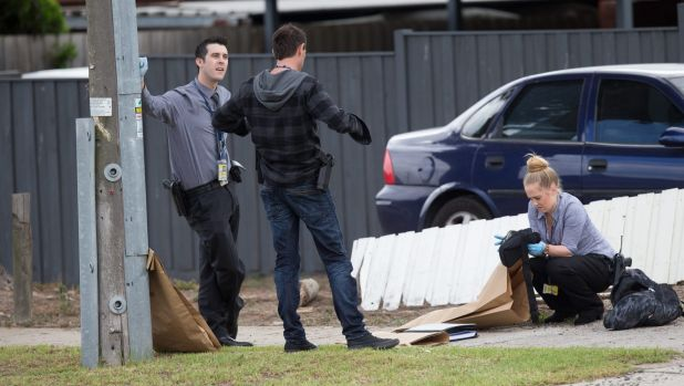 Detectives bag evidence at the scene in Dandenong.
