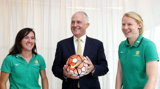 Support: Prime Minister Malcolm Turnbull with Matildas co-captains Lisa De Vanna and Clare Polkinghorne.