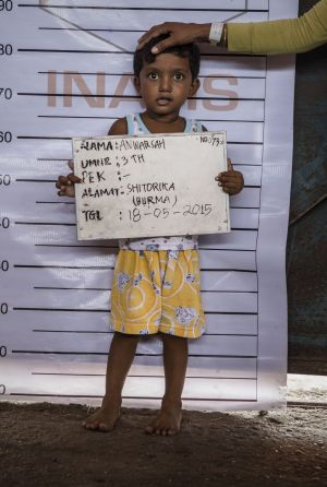 Three-year-old Anwarsah, a Rohingya child, poses for an identification photo at a temporary shelter in Aceh province, ...