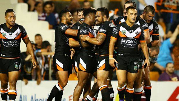 Party time: The Tigers celebrate one of their seven tries.