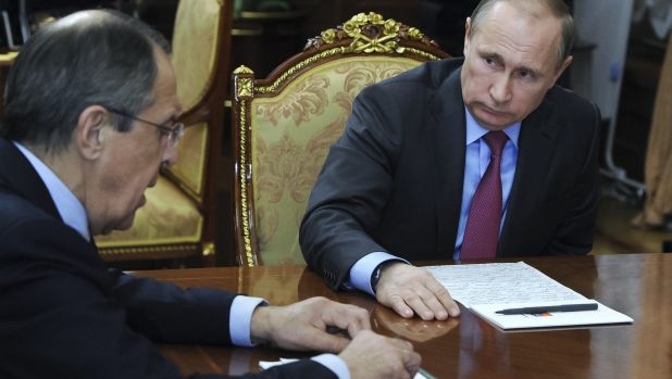 Russian President Vladimir Putin, right, listens to Russian Foreign Minister Sergey Lavrov during their meeting in the ...
