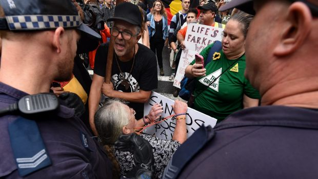 Colleen Fuller, 57 (seated in wheelchair), during a protest against the state government's crackdown on protests on Tuesday.