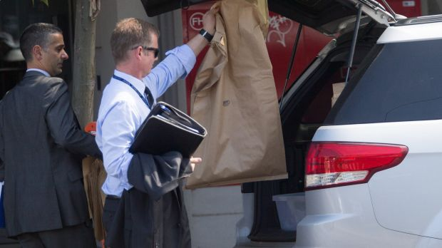 Police gather evidence at the scene where Joseph Acquaro's body was found on Tuesday morning.