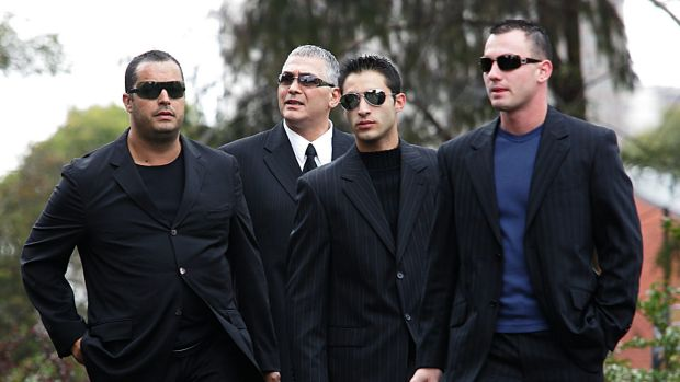 Mick Gatto (second from left) and crew arrive at Saint Ignatius Church in Richmond for the funeral of Mario Condello.
