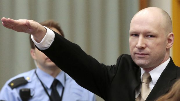 Norwegian mass killer Anders Behring Breivik gives the Nazi salute as he enters the courtroom.