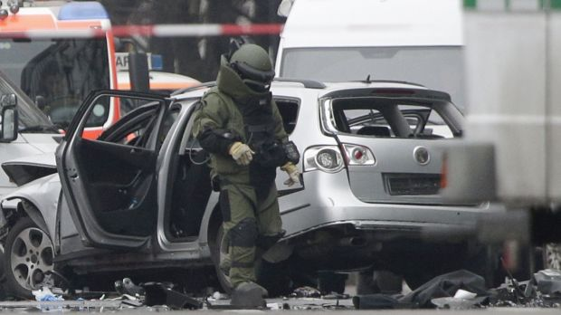 A bomb disposal specialist investigates the site of the blast.