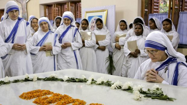 Nuns of Missionaries of Charity, the order founded by Mother Teresa, join in a special mass in relation to her canonisation.