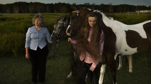Kim-Leanne King, with her youngest daughter Madeline and their Appaloosa horses, worries she exposed her children to poison.