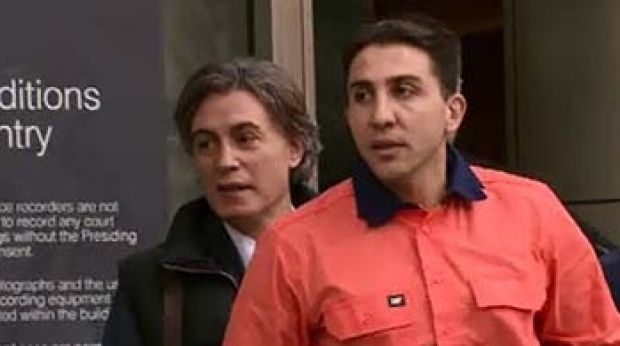 """Court in the act: Gangland lawyer Joe """"Pino"""" Acquaro, since murdered, leaves court with client Rocco Arico, in 2015."""