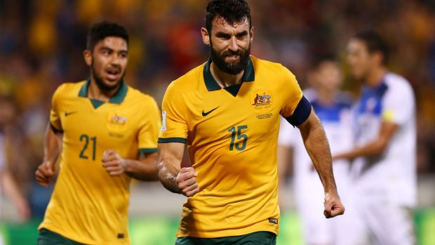 Leading the way: Mile Jedinak.