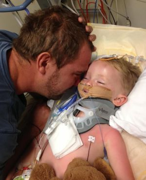Peter Atkinson spends precious moments with his son Darcy in hospital in 2012.