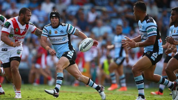 Sending it wide: Michael Ennis passes during the round two NRL match between the Cronulla Sharks and the St George ...