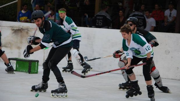 Two of the now 115 teams take to the rink to battle it out  in the Street Roller Hockey League