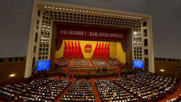 Delegates attend the close of the annual National People's Congress in Beijing's Great Hall of the People.
