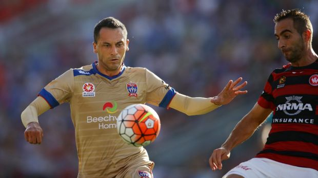 Eyes on the ball: Milos Trifunovic tries to control possession for Newcastle against Western Sydney.