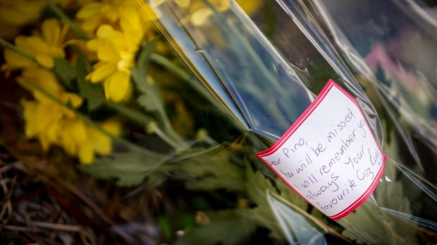 A floral tribute laid for Joseph Acquaro near his Brunswick East cafe on Wednesday.