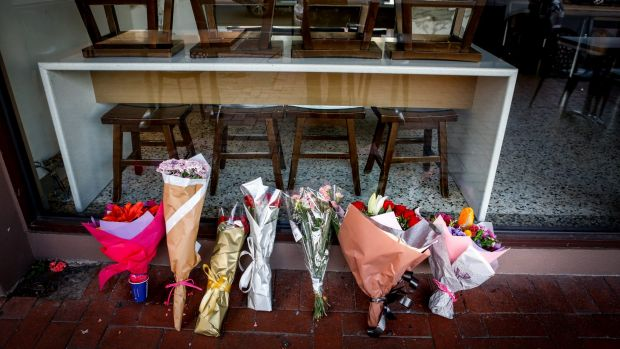 Tributes for Joseph Acquaro in front of his Brunswick East cafe on Wednesday.