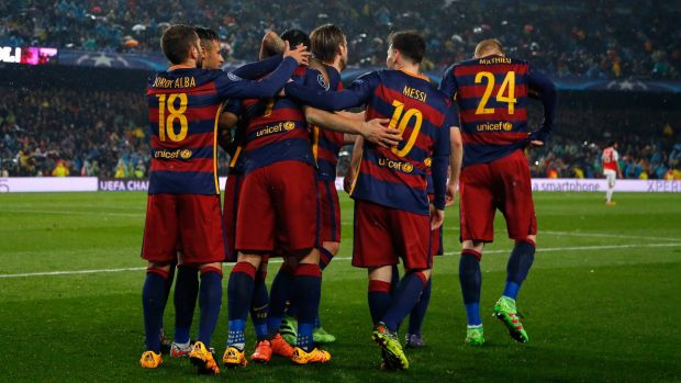 Change of scene? Barcelona players celebrate a second goal against Arsenal.